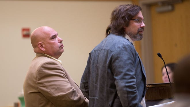 Defendant Daniel Goldberg Sr., left, and his attorney Eric Morrow listen during a court hearing in May in Farmington District Court.