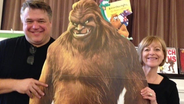Noted illustrator Darrin Brege and his wife author Karen Brege stand with the Bigfoot figure he created for one of their popular books. Bigfoot is an enormous beast which people have reported seeing for years. The Breges recently spoke at the StoryTellers Guild luncheon at The Community House.