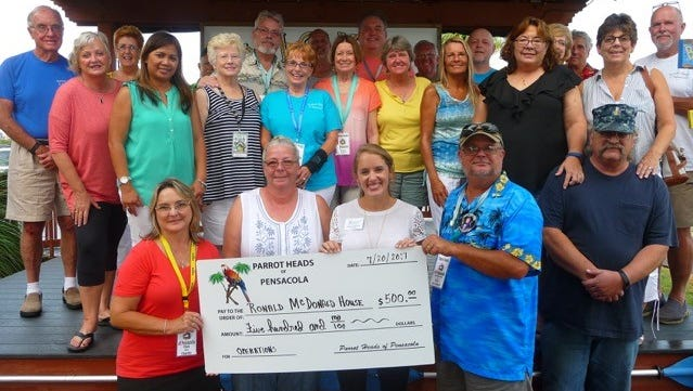 The Parrot Heads of Pensacola make a donation to the Ronald McDonald House.