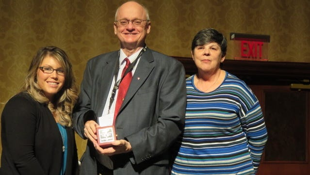 Andrea Burton, executive director of TAHPERD; Tony Kirk, honoree and Diane Klein, president of TAHPERD pose for a picture after Kirk was honored at a banquet.