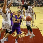 Rising LSU basketball team hosts Tide, after its football team won national title again