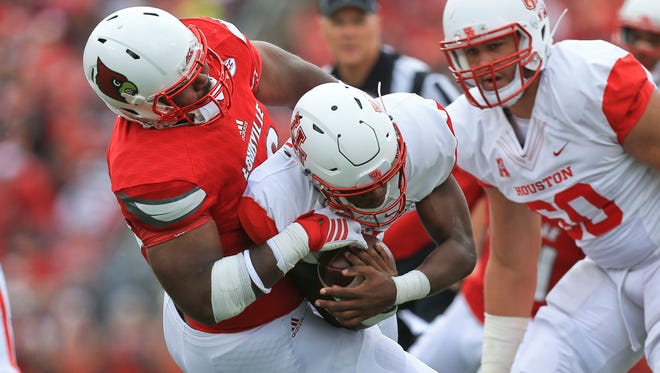 Louisvillle's Sheldon Rankins sacks Houston's Greg Ward, Jr. in the first half while playing Houston Saturday afternoon at Papa John's Cardinal Stadium. Sept. 12, 2015