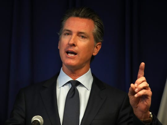 SACRAMENTO, CALIFORNIA - SEPTEMBER 18: California Gov. Gavin Newsom speaks during a news conference at the California justice department on September 18, 2019 in Sacramento, California. California Gov. Gavin Newsom, California attorney general Xavier Becerra and California Air Resources Board Chair Mary Nichols held a news conference in response to the Trump Administration's plan to revoke California's waiver to establish vehicle emissions standards for greenhouse gas emissions and standards to require manufacturers to sell zero emissions vehicles.
