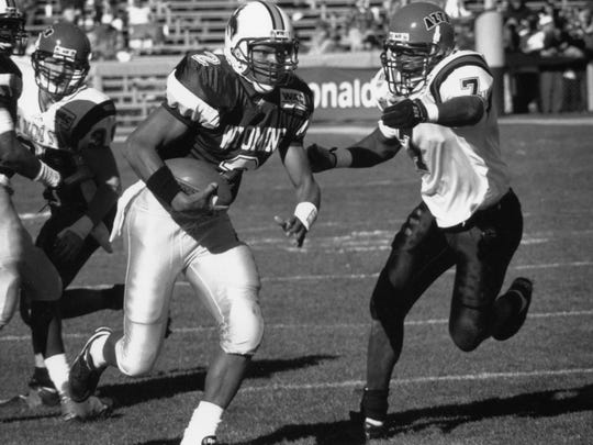Rich Peace was a wide receiver and kick returner from 1993-96 for the Wyoming Cowboys. His coach, Joe Tiller, died last September.
