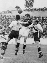 English midfielder Thomas Finney, center, tries to