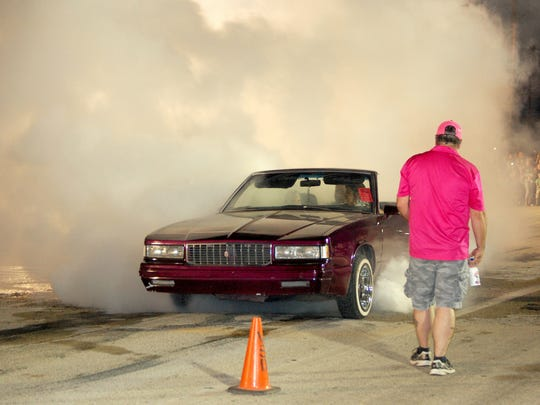VERNON – A 1987 Grand Prix convertible driven by Jessie Rodriguez sends a cloud of smoke over spectators as his spinning wheels made an effort in the competition to produce smoke. Burning rubber highlighted Summer's Last Blast activities on Friday evening in Vernon when vehicles took part in the burn out competition sponsored the members of the Vernon Street Machine and Classics Association.