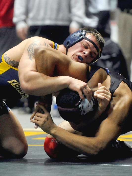Eastern York's Alex Cooley, left, qualified for the PIAA Class AAA Championships at 195 by finishing four Saturday. (Daily Record/Sunday News -- Chris Dunn)