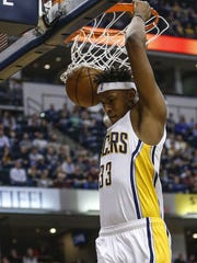 Indiana Pacers center Myles Turner (33) dunks against the New Orleans Pelicans in the first half at Bankers Life Fieldhouse on Monday, Jan. 16, 2017.