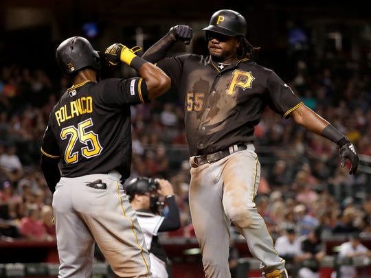 Pittsburgh Pirates' Josh Bell celebrates his two-run home run with Gregory Polanco (25), during the fifth inning of the team's baseball game against the Arizona Diamondbacks on Tuesday, May 14, 2019, in Phoenix. (AP Photo/Matt York)