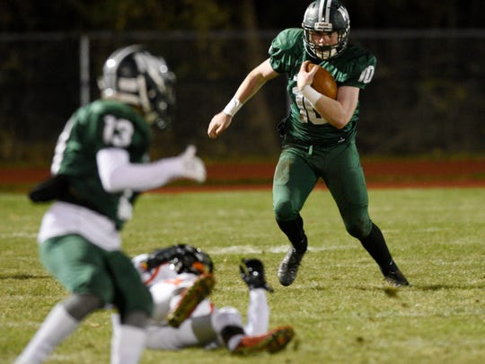 Hasbrouck Heights at New Milford on Friday, November 17, 2017.  NM #10 Matt McElroy runs with the ball in the first quarter.