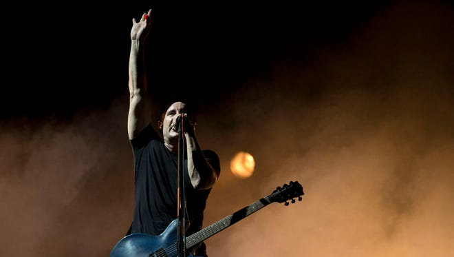 "In this March 27, 2014 photo, Trent Reznor of Nine Inch Nails performs at the Vive Latino music festival in Mexico City, Mexico. ""In these few years, I kind of accidentally got into scoring films. I started a new band: How to Destroy Angels; we put two records out. I tried writing a TV show for HBO, which failed. I started a family, and surprisingly, I found myself inspired by that,"" Reznor said. (AP Photo/Rebecca Blackwell)"
