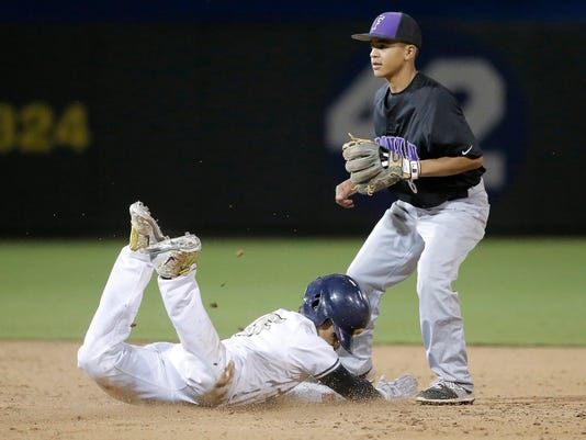 Coronado's Christian Smith colides with Franklin's Jimmy de Leon at second base during their game Thursday at Southwest University Park.