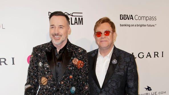 David Furnish  and Elton John arrive at their Oscars