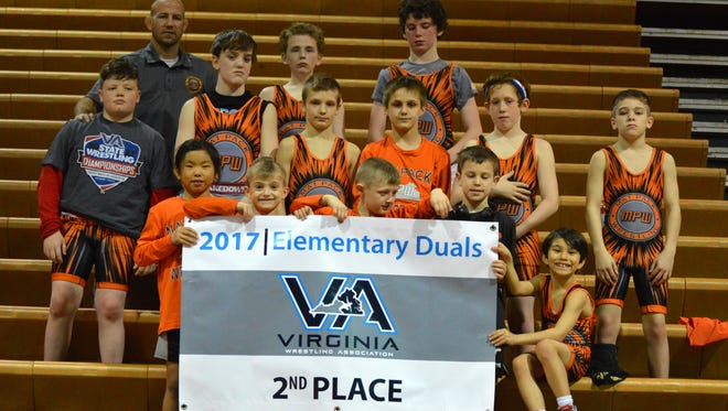 Members of the Mat Pack Wrestling Club pose with the banner they receives for placing second at the Virginia Amateur Wrestling Association's Elementary School Duals on Saturday, Feb. 256, 2017, at the Arthur Ashe Center in Richmond, Va., on Sunday, Feb. 26, 2017.