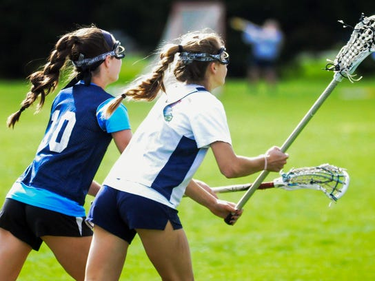 Worcester Prep's Leigh, left, and Regan Lingo move