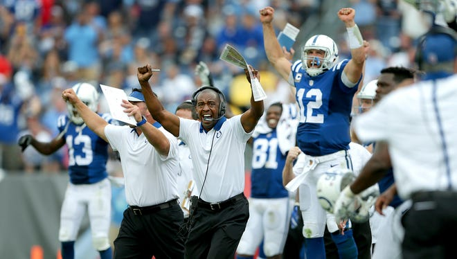 Indianapolis Colts offensive coordinator Pep Hamilton and quarterback Andrew Luck begin to celebrate a win in the final minute of their game Sunday, September 27, 2015 at Nissan Stadium in Nashville TN.