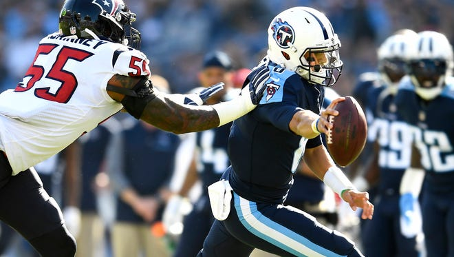 Titans quarterback Marcus Mariota (8) stretches the ball out short of a first down during the first half of a game at Nissan Stadium Sunday, Dec. 3, 2017 in Nashville, Tenn.