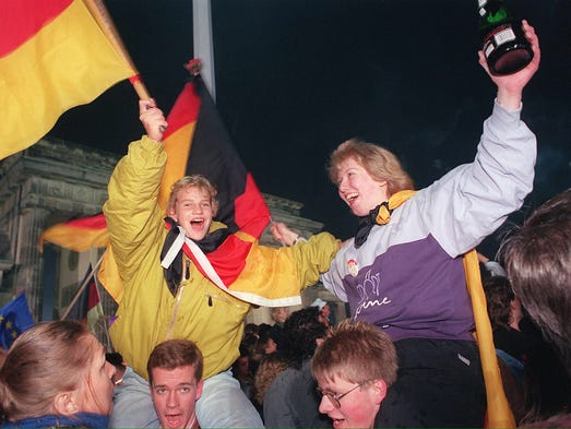 Germans wave flags during the celebration of the country's