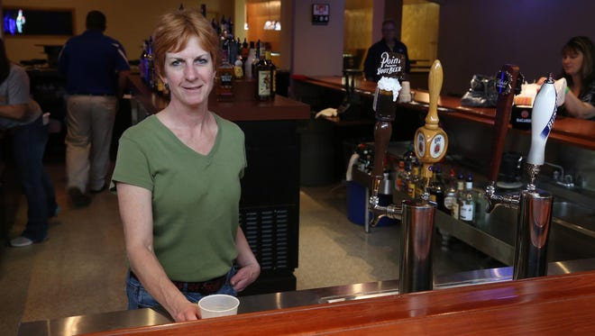 Manager Lisa Strathmann stands at the bar at LJ's Sports Zone & Grill in Stratford on Thursday.