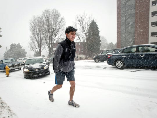 Movoto says Indianapolis is known for wearing shorts in cold weather, but look at this. Medical student Josh Pan wears shorts as he makes his way into the Wake Forest Baptist Medical Center in Winston-Salem, N.C., during a February snowfall.