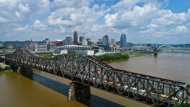Drone footage over the Ohio River shows the Cincinnati, Ohio skyline from Covington, Kentucky, on Thursday, Aug. 3, 2017. (Carrie Cochran & Sam Greene / USA Today Network)
