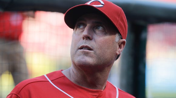 Reds manager Bryan Price works the dugout in the seventh inning of a game against the Oakland Athletics on June 11. The Reds won 2-1.
