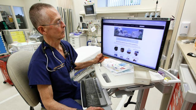 ADVANCE FOR USE MONDAY, MARCH 13, 2017 AND THEREAFTER-Dr. Garen Wintemute, an emergency room physician at the University of California, Davis, Medical Center, shows the website of the Bureau of Alcohol, Tobacco and Firearms, on a computer in the hospital in Sacramento, Calif., on Thursday, March 9, 2017. On the day President Donald Trump was inaugurated, Wintemute got a call from a colleague, who reported that the White House had removed a climate change page from its website. Fearing that federal data on gun violence might soon similarly vanish under a president with close ties to the National Rifle Association, Wintemute called together his partners at the UC Davis Violence Prevention Research Program. He then ticked off the records he wanted to archive. (AP Photo/Rich Pedroncelli) ORG XMIT: NY711
