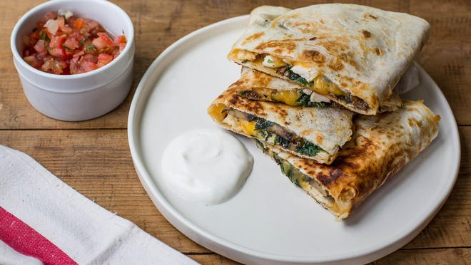 Spinach, mushroom and chicken quesadillas are a quick dinner.