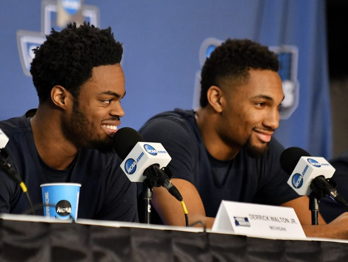 From left, Michigan guards Derrick Walton, Jr. and