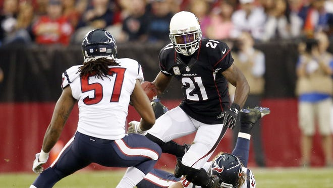The Cardinals' Patrick Peterson returns a punt against the Texans' Justin Tuggle (57) during the third quarter of NFL play at University of Phoenix Stadium in Glendale on November 10, 2013.