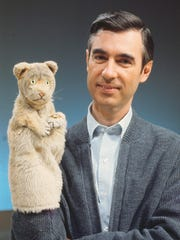 "Fred Rogers and puppet Daniel Tiger from his show ""Mr."