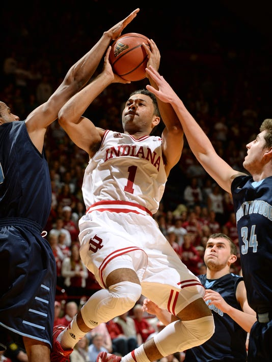 Indiana guard James Blackmon Jr. (1) puts the ball up as Northwood forward Charlie Ryan (34) and guard Jermaine Myers (5) defend during an NCAA college basketball exhibition game Thursday, Nov. 6, 2014, in Bloomington, Ind. (AP Photo/The Herald-Times, Chris Howell)