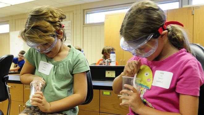 Adeline Rhoads and Ruby Hughes mix ingredients together to make a bouncing ball, during ChemKids. A class during the LEAPS program, which is a week of hands-on, active learning program for kids 2nd thru 4th grades, held Wednesday at UW-Fond du Lac.