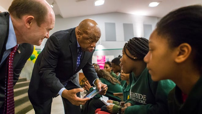 Rep. John Lewis speaks to children during an assembly at East Side Charter School in Wilmington on Friday morning.