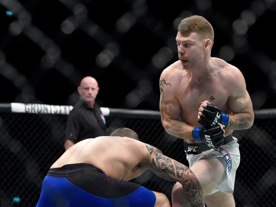 Stevie Ray (red gloves) fights Paul Felder (blue gloves) during UFC Fight Night at SSE Hydro on July 16, 2017.