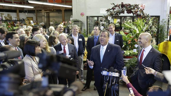 New Jersey Gov. Chris Christie campaigns in San Francisco for California GOP gubernatorial candidate Neel Kashkari, right. He disagreed with Texas Gov. Rick Perry's comparison of homosexuality with alcoholism. (Eric Risberg / Associated Press)