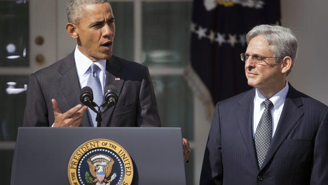 President Barack Obama introduces federal appeals court Judge Merrick Garland, right, as his nominee to the U.S. Supreme Court in March 2016. The GOP-controlled Senate refused to hold a hearing on Garland's nomination.