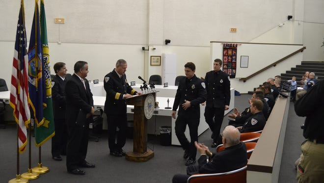 Binghamton police officers Matthew Hodnik and Daniel Ostanek are recognized Thursday during the department's awards ceremony at City Hall for their roles in the arrests of two suspects in a March shooting in Johnson City.
