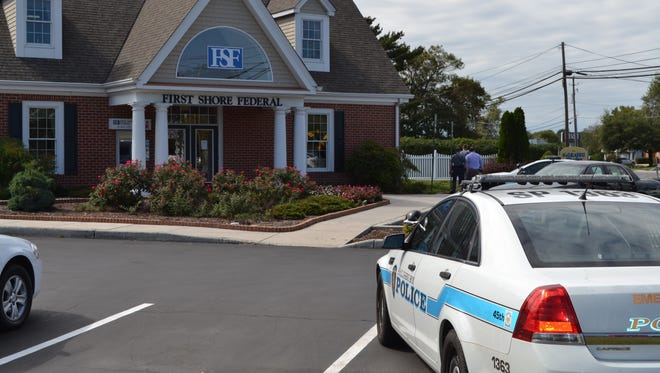 Police investigate an armed robbery at First Shore Federal on Mount Hermon Road in Salisbury on Monday, Sept. 26, 2016