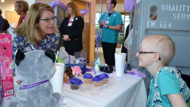 Diane Hitchens, left, director of Women's and Children's Services at Peninsula Regional Medical Center, chats with cancer patient Brooke Mulford during a toy drive for Brooke's Toy Closet on Monday, Oct. 17, 2016.