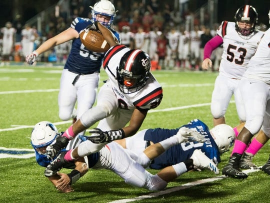 Lumberton's offensive line has helped running back Robert Henry to 854 rushing yards and eight touchdowns.