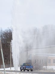 Water erupts from an Ontario water main Tuesday near