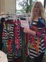 Tiffany Rupp of Resort Fashions by Tiffany checks over