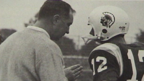 Livonia Stevenson football coaching icon Jack Reardon is pictured instructing his quarterback  during a 1969 game.