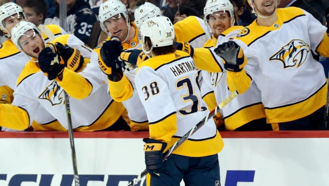 Predators right wing Ryan Hartman (38) celebrates his game-winning goal against the Jets in the third period Tuesday.
