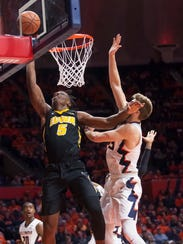 Iowa forward Tyler Cook (5) shoots while being defended