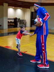 Zeus McClurkin of the Harlem Globetrotters plays hoops