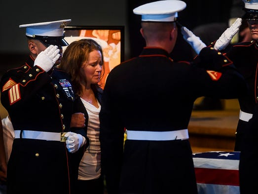 Sue Vicary, overlooks her son's casket during his funeral service, Tuesday, August 26, 2014 at Faith Evangelical Free Church in Fort Collins, CO. Brennan Ching died in a car crash August 15 while traveling home to see his little brother. Ching, a marine, received full military honors.