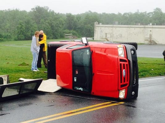 A truck rolled over at Willow Springs Circle and Willow Springs Lane in Manchester.