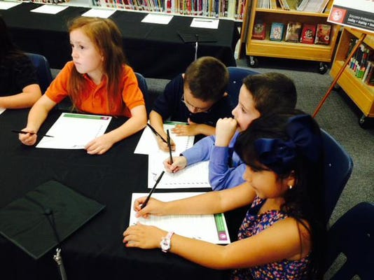 Bill Sybert School students, right to left, Jazmin Estrada, Erik Quintero, Matthew Land and Sophia Spengler, signed pledges last week  to participate in the new WIN Academy being offered next year in the SISD.